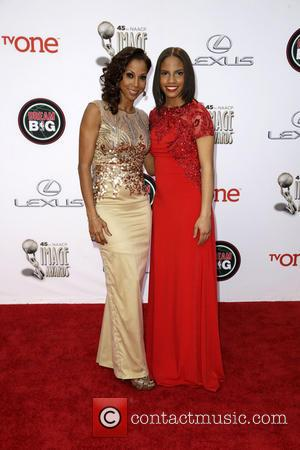 Holly Robinson Peete and Guest