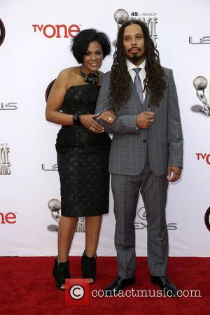 Beverly Bond and Guest - 45th NAACP Image Awards at Pasadena Civic Auditorium - Arrivals - Los Angeles, California, United...