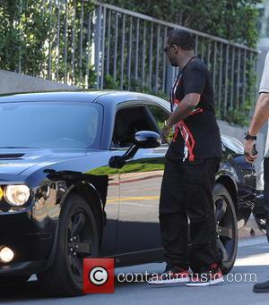 Sean Combs - Sean Combs chats up a woman in the middle of the street before going to a meeting...