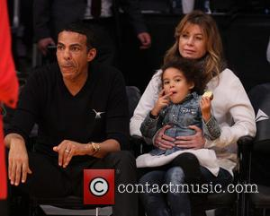 Ellen Pompeo and Chris Ivery - Celebrities out at Staples Center. The Brooklyn Nets defeated the Los Angeles Lakers by...