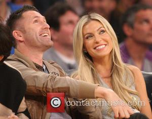 Robbie Keane and Claudine Palmer - Celebrities out at Staples Center. The Brooklyn Nets defeated the Los Angeles Lakers by...