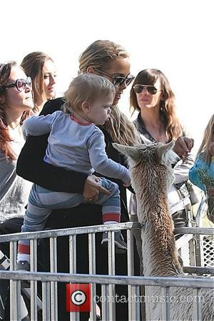 Elizabeth Berkley - Elizabeth Berkley takes her son, Sky for a pony ride at the Farmers Market in Beverly Hills...