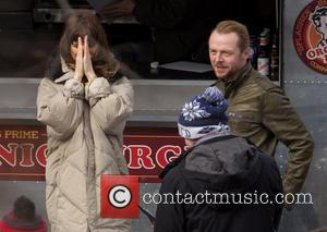 Simon Pegg and Lake Bell - Simon Pegg and Lake Bell take a break from filming on the set of...