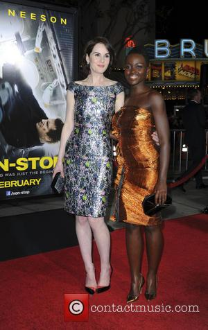 Michelle Dockery and Lupita Nyong'o - Film Premiere Non Stop - Los Angeles, California, United States - Tuesday 25th February...