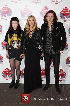 Abbey Clancy, Abbey Crouch and guest - The NME Awards 2014 held at O2 Academy Brixton - Arrivals - London,...
