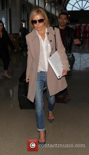 Kelly Ripa - Kelly Ripa arrives at Los Angeles International Airport (LAX) wearing a sheer top and ankle jeans -...