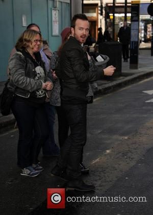 Aaron Paul - Breaking Bad actor Aaron Paul pictured in Central London signing for fans - London, United Kingdom -...