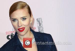 Scarlett Johansson Shows Off Blossoming Figure At Captain America Premiere