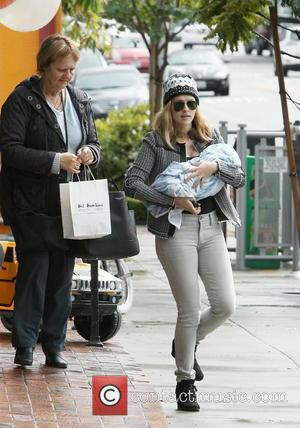 Teresa Palmer and Bodhi Webber - Australian actress Teresa Palmer holding newborn son Bodhi in her arms as she leaves...