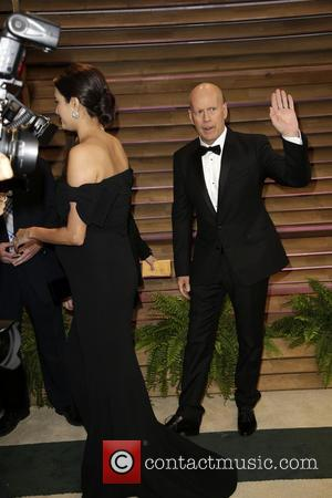 Emma Heming and Bruce Willis - 2014 Vanity Fair Oscar Party held at Sunset Tower in West Hollywood - Los...