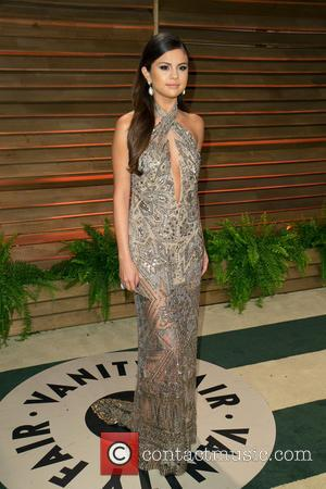 Selena Gomez - 2014 Vanity Fair Oscar Party held at Sunset Tower in West Hollywood - Arrivals - Los Angeles,...
