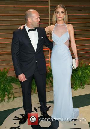 Jason Statham and Rosie Huntington-Whiteley - Celebrities attend 2014 Vanity Fair Oscar Party at Sunset Plaza. - Los Angeles, California,...
