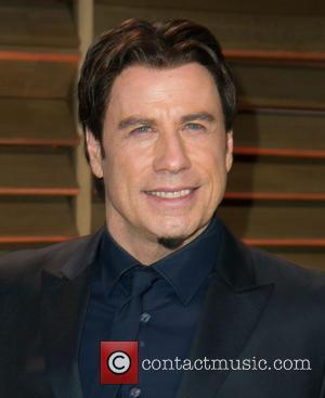 John Travolta - Celebrities attend 2014 Vanity Fair Oscar Party at Sunset Plaza. - Los Angeles, California, United States -...