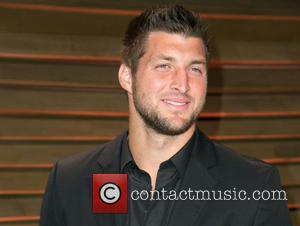 Tim Tebow - Celebrities attend 2014 Vanity Fair Oscar Party at Sunset Plaza. - Los Angeles, California, United States -...
