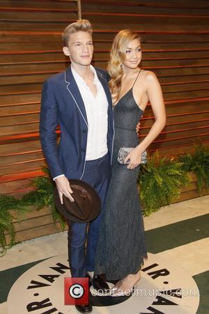 Singer Cody Simpson (l) and Model Gigi Hadid - 2014 Vanity Fair Oscar Party in West Hollywood - London, United...