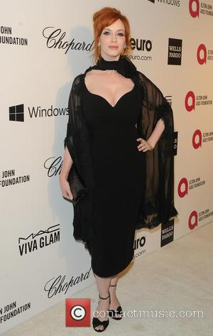 Elton John and Cristina Hendricks