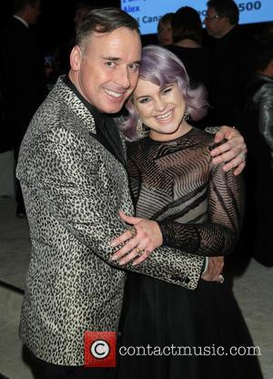 David Furnish and Kelly Osbourne - 22nd Annual Elton John AIDS Foundation Academy Awards Viewing/After Party - Inside - Los...