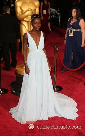 Lupita Nyong'o - The 86th Annual Oscars held at Dolby Theatre - Red Carpet Arrivals - Los Angeles, California, United...