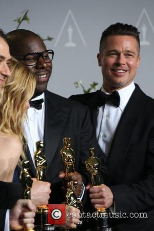 Brad Pitt (r) and director Steve McQueen - The 86th Annual Oscars - Press Room - Los Angeles, California, United...