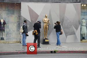 Street artists Plastic Jesus has placed his controversial art installation of an 8-foot replica Oscar award holding a syringe to...