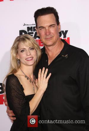 Patrick Warburton and Cathy Jennings - Premiere Of Twentieth Century Fox And DreamWorks Animation's