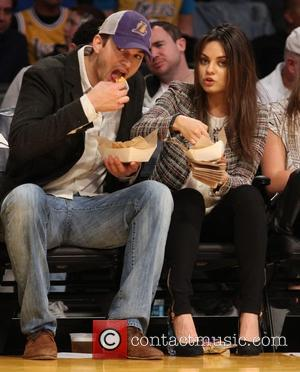 Ashton Kutcher and Mila Kunis - Celebrities courtside at the Los Angeles Lakers v New Orleans Pelicans NBA basketball game...