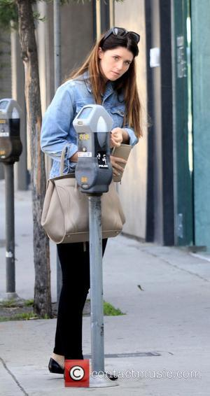 Katherine Schwarzenegger - Katherine Schwarzenegger pays at a parking meter wearing a denim jacket and flat shoes before dashing off...