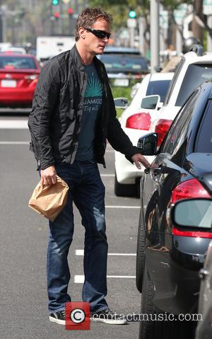 Rande Gerber - Rande Gerber returns to his car after taking a walk in a sunny Beverly Hills - Los...