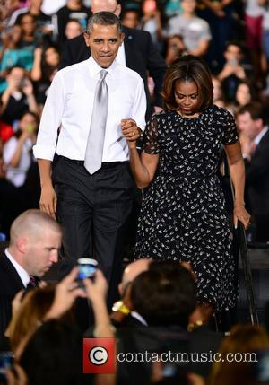 President Barack Obama and First Lady Michelle Obama - U.S. President Barack Obama and First Lady Michelle speak on the...