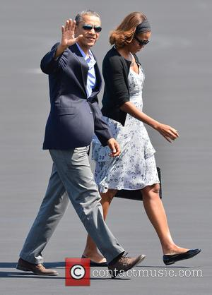 United States president Barack Obama and First Lady Michelle Obama - United States President Barack Obama and First Lady Michelle...