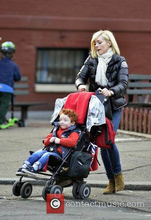 Jane Krakowski and Bennett - Jane Krakowski pushes her son Bennett in a stroller while out and about in Manhattan...