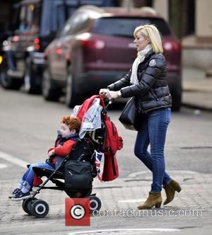 Jane Krakowski and Bennett - Jane Krakowski pushes her son Bennett in a stroller while out and about in Manhattan...