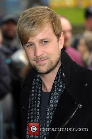 Kian Egan - The Tric Awards 2014 held at the Grosvenor House Hotel - Arrivals - London, United Kingdom -...