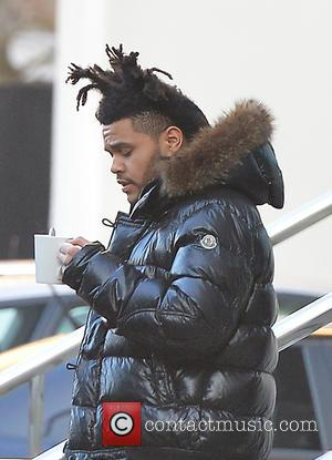 The Weeknd and Abel Tesfaye - The Weeknd leaving the Lowry Hotel holding what appears to be a mug of...