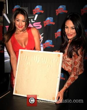 Nikki Bella and Brie Bella - WWE wrestlers and reality stars of E! series