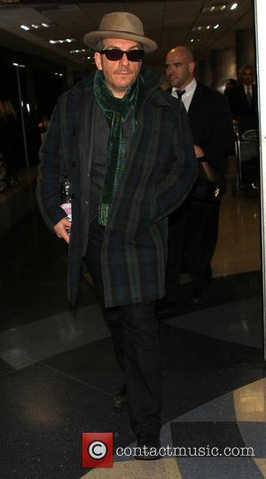 Elvis Costello - Elvis Costello at Los Angeles International Airport (LAX) - Los Angeles, California, United States - Thursday 13th...