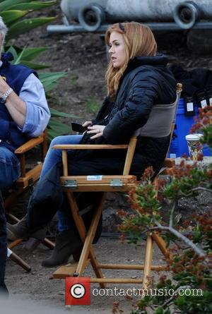 Isla Fisher - Isla Fisher shows off her huge pregnant belly bump while on the set of her new movie...
