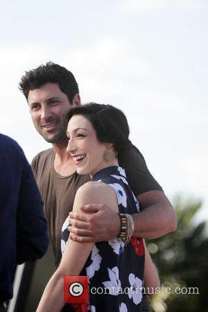 Meryl Davis and Maksim Chmerkovskiy - Dancing with the Stars celebrities appear on 'Extra' at Universal Studios - Los Angeles,...