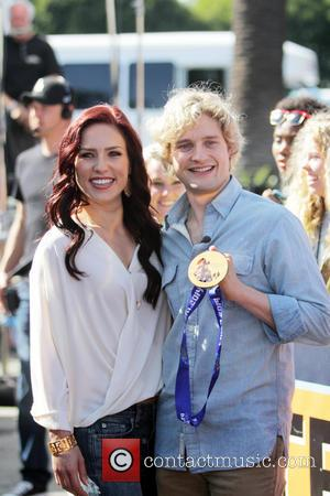 Sharna Burgess and Charlie White - Dancing with the Stars celebrities appear on 'Extra' at Universal Studios - Los Angeles,...