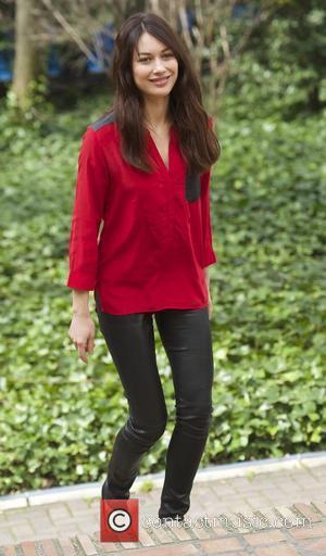 Olga Kurylenko - 'A Perfect Day' Madrid photocall at Casa de America - Madrid, Spain - Friday 14th March 2014