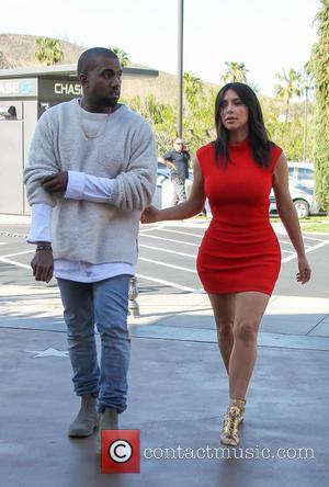 Kanye West and Kim Kardashian - Kanye West takes fiancee Kim Kardashian to see the new movie 'Need For Speed'...