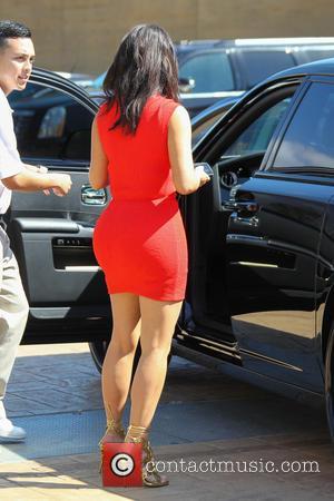 Kim Kardashian - Kim Kardashian, wearing a bright red figure hugging dress, goes to lunch at Nobu Malibu after stopping...