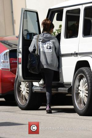 Brenda Song - Brenda Song attempts to hide her face with her sweatshirt whilst leaving the gym - Los Angeles,...