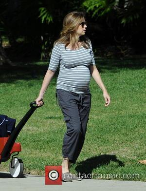 Jenna Fischer - Heavily pregnant Jenna Fischer takes a morning stroll with son Weston, riding in a  Radio Flyer...