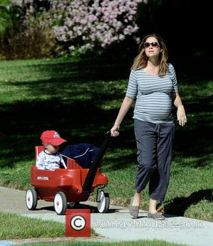 Jenna Fischer, Weston and Weston Kirk - Heavily pregnant Jenna Fischer takes a morning stroll with son Weston, riding in...