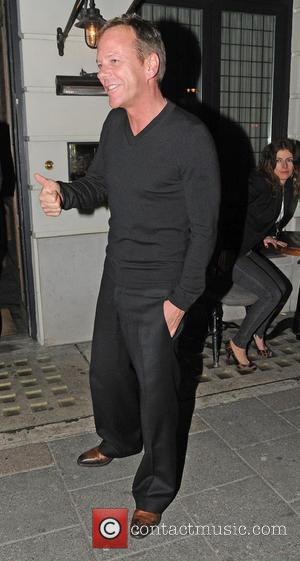 Kiefer Sutherland - Kiefer Sutherland steps outside Little House Mayfair restaurant to have a cigarette after having dinner with friends...