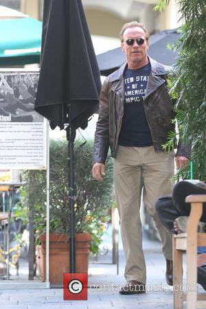 Arnold Schwarzenegger - Arnold Schwarzenegger and Ralf Moeller are  leaving Le Pain Quotidien cafe at the Brentwood with his...