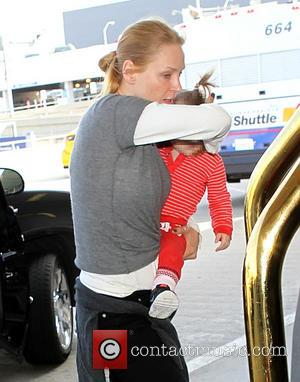 Uma Thurman and Luna Thurman-Busson - Uma Thurman tries to keep her face hidden as she arrives at Los Angeles...