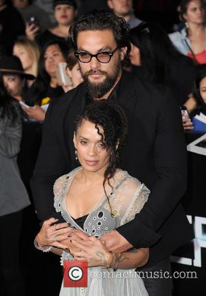 Lisa Bonet and Jason Momoa - Premiere of 'Divergent' held at the Regency Bruin Theatre - Arrivals - West Hollywood,...