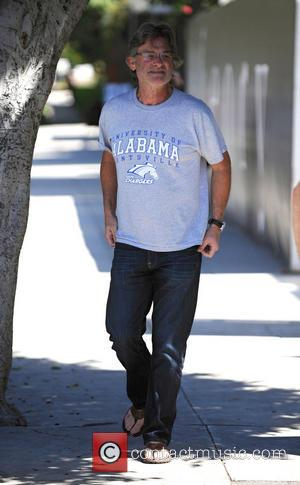Kurt Russell - Kurt Russell wearing a University of Alabama in Huntsville and walking in sandals had lunch in Brentwood....